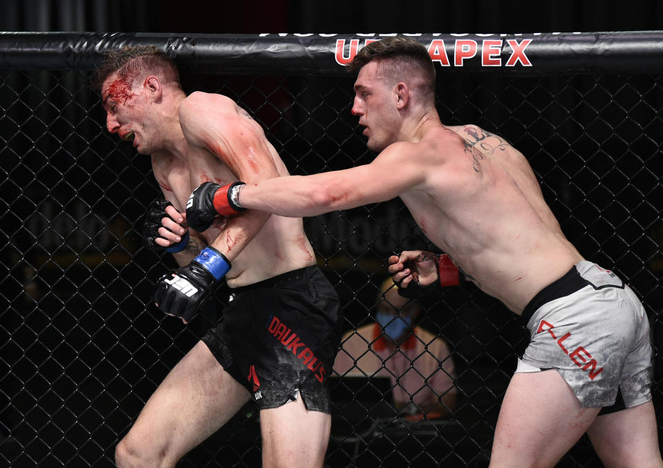 Brendan Allen punches Kyle Daukaus in the octagon.