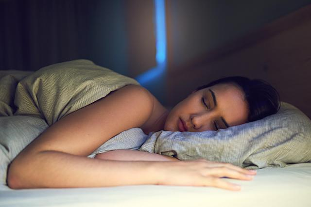 Sleeping on your side can help you get a good night's sleep (Getty)