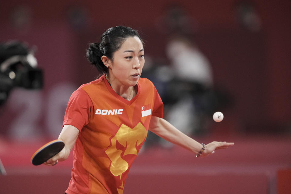 Singapore paddler Yu Mengyu in action against Portugal's Shao Jieni in her opening women's singles match at the Tokyo Olympics. (PHOTO: SNOC/Kong Chong Yew)