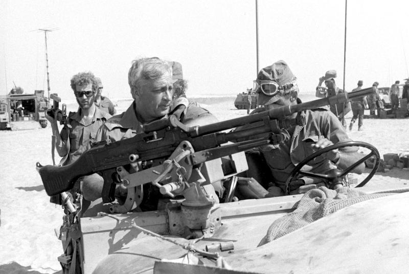 File photo of Israeli Major General in the Reserves Sharon riding in a jeep