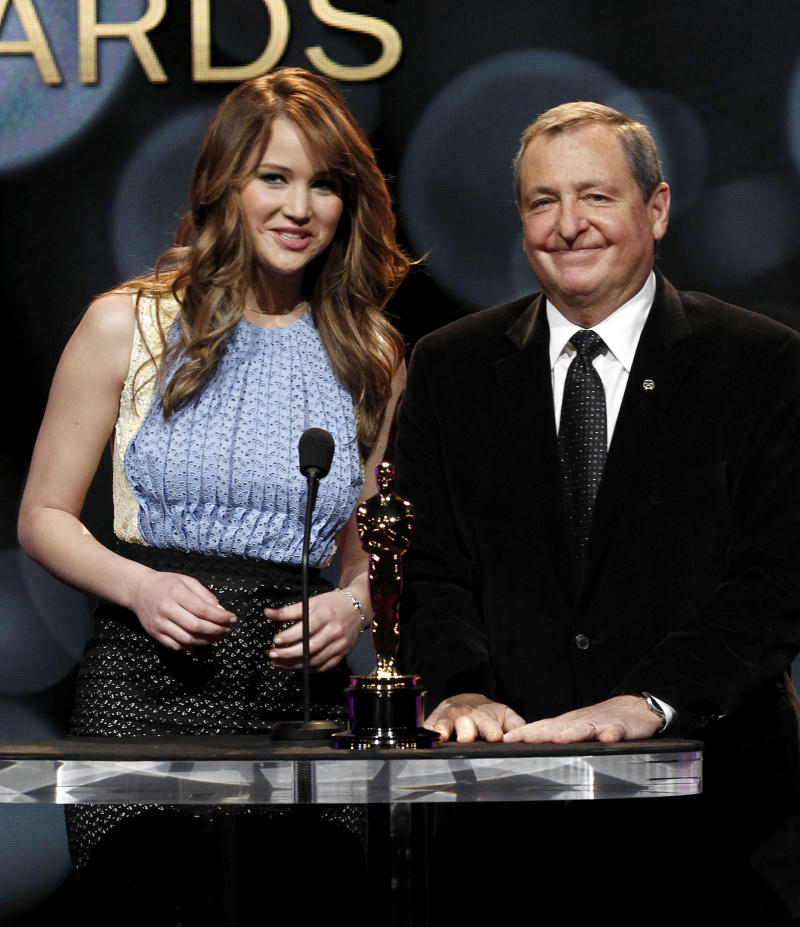 FILE - This Jan. 24, 2012 file photo, actress Jennifer Lawrence, left, and the Academy of Motion Picture Arts and Sciences President Tom Sherak are seen at the start of the nominations for the 84th Annual Academy Awards, in Beverly Hills, Calif. Sherak, a former Academy of Motion Picture Arts and Sciences president, has died of prostate cancer at 68, the Academy confirmed on Tuesday, Jan. 28, 2014. Sherak was surrounded family at his home in Calabasas, Calif. (AP Photo/Matt Sayles, File)