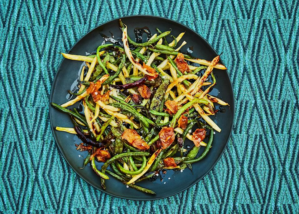 "Beautifully crisp with just the right amount of char, this loose riff on a three-bean salad covers your textural bases. This also can be serve at room temperature! <a href=""https://www.bonappetit.com/recipe/charred-bean-and-pea-salad?mbid=synd_yahoo_rss"" rel=""nofollow noopener"" target=""_blank"" data-ylk=""slk:See recipe."" class=""link rapid-noclick-resp"">See recipe.</a>"