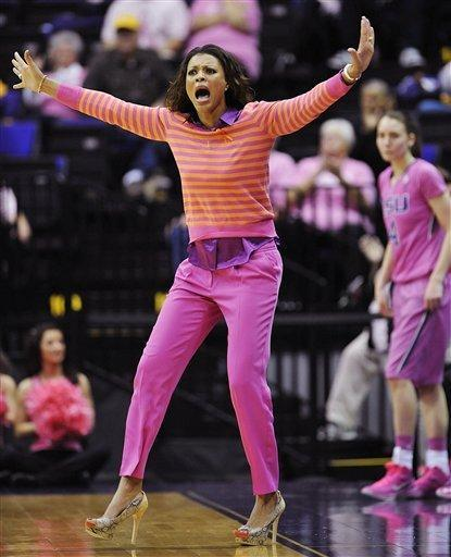 LSU head coach Nikki Caldwell reacts to a call during the second half of an NCAA college basketball game against Georgia in Baton Rouge, La., Sunday, Feb. 10, 2013. LSU guard Anne Pedersen (4) watches from the bench. LSU won 62-54. (AP Photo/Bill Feig)