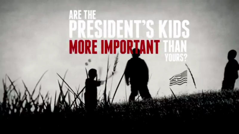 """This frame grab image shows a scene from video released by the National Rifle Association. In a sharp pushback against any new gun regulations, the NRA posted a Web video on Wednesday, Jan. 16, 2013, that labels President Barack Obama an """"elitist hypocrite"""" for allowing his daughters to be protected by armed Secret Service agents while not embracing armed guards for schools. """"Are the president's kids more important than yours?"""" a male narrator asks in the video. """"Then why is he skeptical of putting armed security in schools, when his kids are protected by armed guards in their school?"""" (AP Photo/NRA)"""