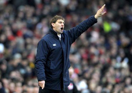 Portsmouth's manager Adams reacts during their English Premier League soccer match against Arsenal at the Emirates stadium in London