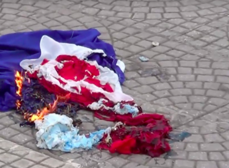 The French flag - not a Dutch one - lies in ashes (Picture: Ruptly)