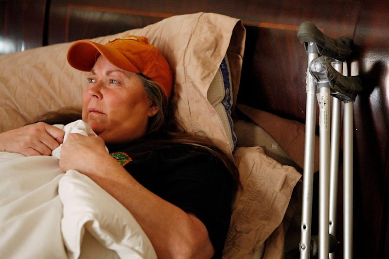 In this photo taken Thursday, Dec. 2, 2010, entertainer Jeneane Marie Cranert lies in bed at her home in Las Vegas. The Vegas veteran, who has performed with Frank Sinatra and Liberace, has a bone disease in her hip and is in need of surgery. She doesn't have health insurance and can't afford hip replacement surgery. (AP Photo/Isaac Brekken)