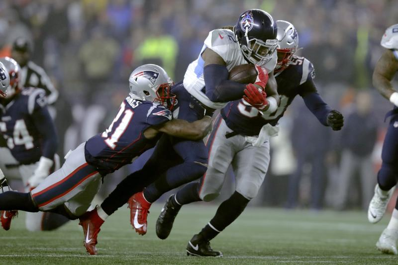 New England Patriots defensive back Jonathan Jones, left, tries to bring down Tennessee Titans running back Derrick Henry in the first half of an NFL wild-card playoff football game, Saturday, Jan. 4, 2020, in Foxborough, Mass. (AP Photo/Charles Krupa)
