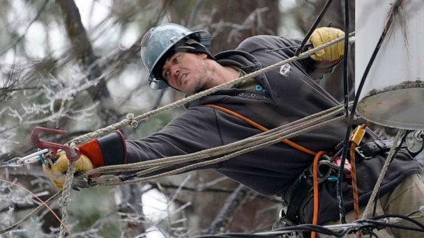 PHOTO: Lineman Sean Gregory stretches for a cable as he repairs a transformer in Jackson, Miss., Feb. 18, 2021. (Rogelio V. Solis/AP)