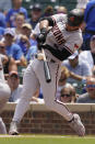 Arizona Diamondbacks' Eduardo Escobar hits a double during the first inning of a baseball game against the Chicago Cubs in Chicago, Saturday, July 24, 2021. (AP Photo/Nam Y. Huh)