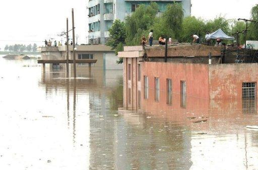 Image provided by North Korea's official Korean Central News Agency shows flooded houses in Anju city in South Phongan province. The flooding represents a challenge for Kim Jong-Un, new leader of a country which has grappled with severe food shortages since a famine in the 1990s killed hundreds of thousands