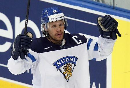 Finland's Jokinen celebrates his goal against Switzerland during the second period of their men's ice hockey World Championship Group B game against Finland at Minsk Arena in Minsk
