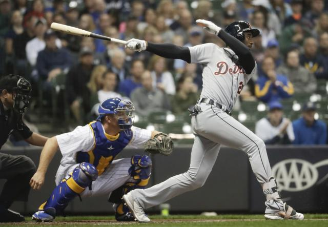 Detroit Tigers' Niko Goodrum hits an RBI single during the first inning of a baseball game against the Milwaukee Brewers Friday, Sept. 28, 2018, in Milwaukee. (AP Photo/Morry Gash)