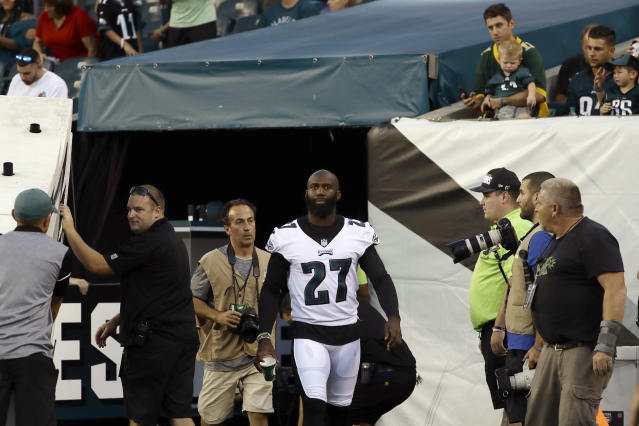 Philadelphia Eagles' Malcolm Jenkins walks onto the field from the locker room after the national anthem before the team's preseason NFL football game against the New York Jets, Thursday, Aug. 30, 2018, in Philadelphia. (AP Photo/Michael Perez)