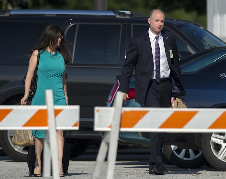 David Coombs, attorney for Army Pfc. Bradley Manning, and his wife, Tanya Monestier, walk to a courthouse at Fort Meade, Md., Friday, July 26, 2013. Coombs will present his closing argument Friday in the court-martial of Manning, who is charged with indirectly aiding the enemy by sending troves of classified material to WikiLeaks. He faces up to life in prison. (AP Photo/Cliff Owen)