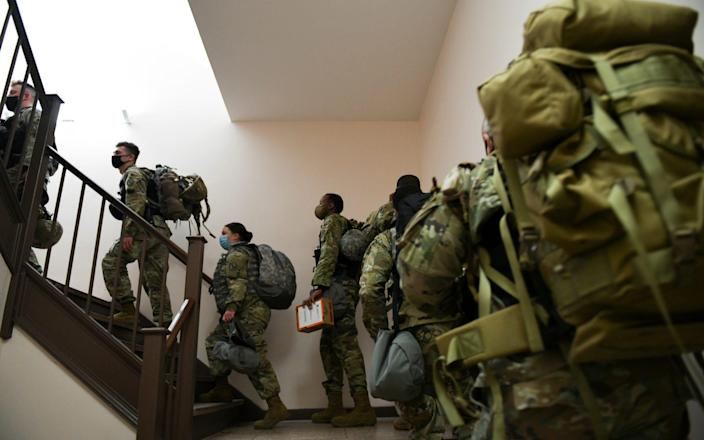 Thousands of National Guard troops will be stationed in Washington for the inauguration - REUTERS