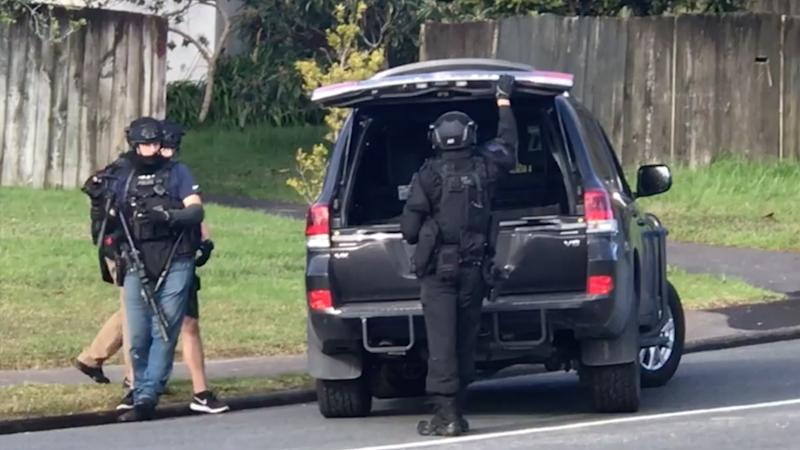 Armed police stormed a home in West Auckland today shortly before 2:30pm and arrested two men over the incident.