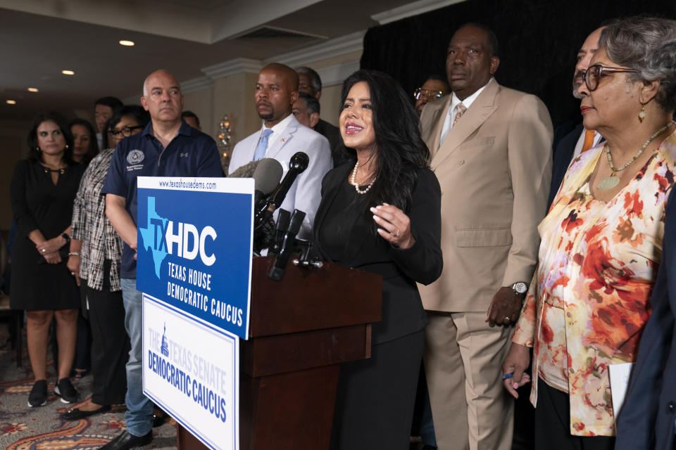 Democratic Texas State Rep. Victoria Neave from Dallas, center, together with his fellow Texas legislators, speaks during a news conference, Wednesday, July 14, 2021, in Washington. (AP Photo/Manuel Balce Ceneta)
