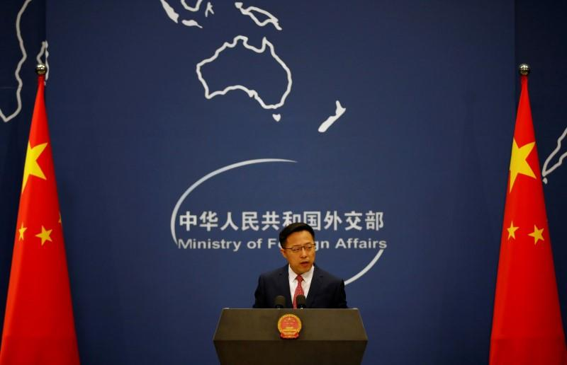 China says U.S. 'addicted to quitting' over plan to withdraw from WHO