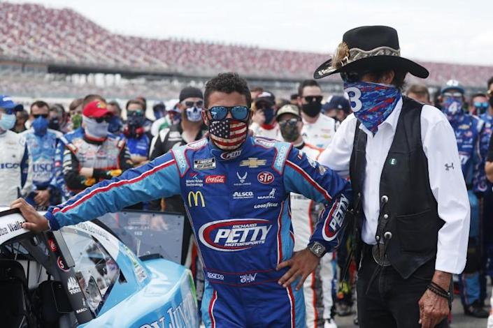 Team owner Richard Petty stands with driver Bubba Wallace.