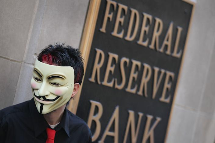 A demonstrator with Occupy Chicago stands outside the Federal Reserve Bank building October 5, 2011 in Chicago, Illinois. The protest is one of many around the country being held in solidarity with the Occupy Wall Street protests currently taking place in New York City. Among the things that demonstrators are protesting is what they believe is greed and corruption among banking and business leaders. (Photo by Scott Olson/Getty Images)