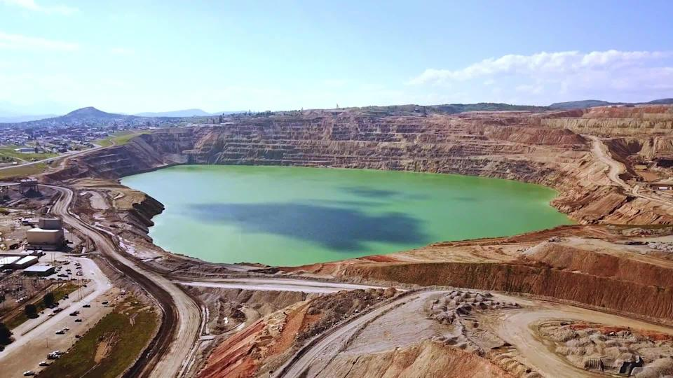 The Berkeley Pit, a former open-pit copper mine in Butte, Montana, became a mile-long lake laden with heavy metals - and a federal Superfund environmental clean-up site. / Credit: CBS News
