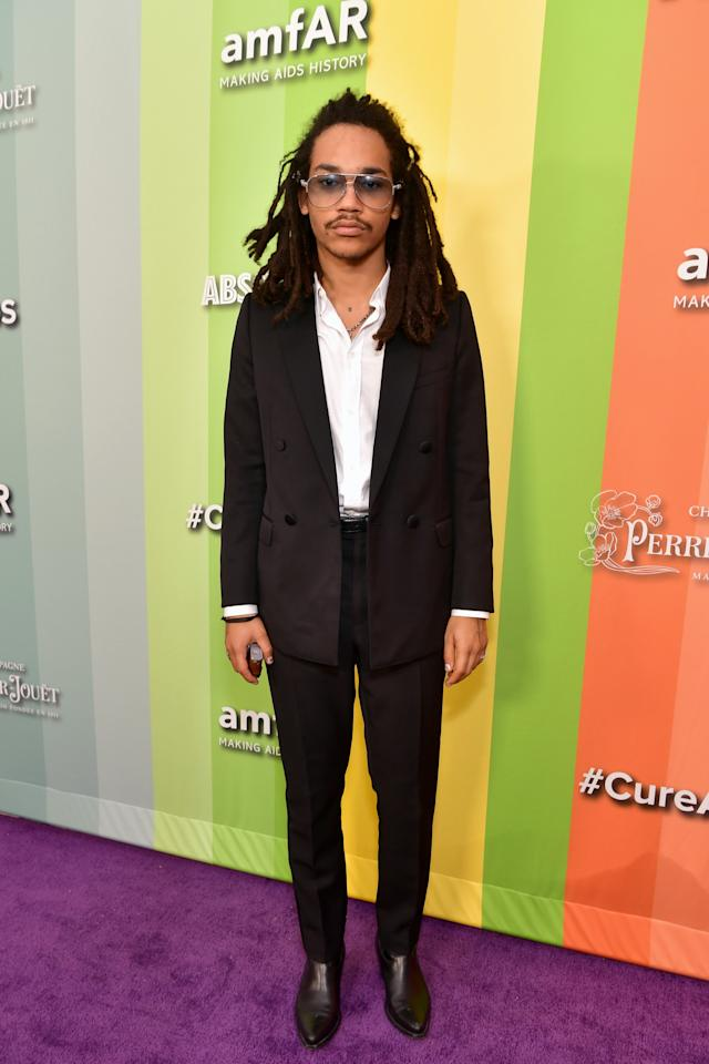 <p>WHERE: The amfAR Gala in Los Angeles</p> <p>WHEN: October 10, 2019</p> <p>WHY: From the visible chain to those pointy boots, Luka Sabbat knows exactly how to wear the classic black suit.</p>