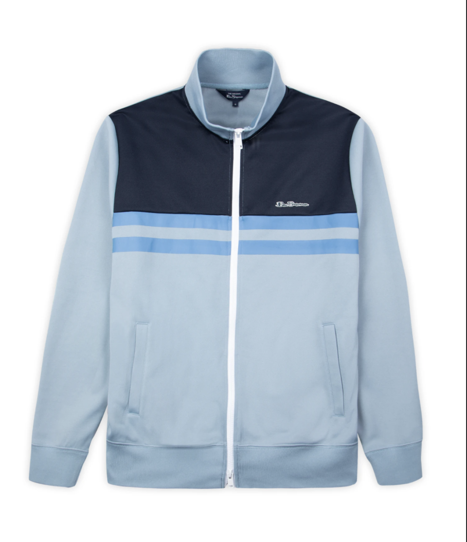 """<p><strong>Ben Sherman</strong></p><p>bensherman.com</p><p><strong>$89.00</strong></p><p><a href=""""https://go.redirectingat.com?id=74968X1596630&url=https%3A%2F%2Fwww.bensherman.com%2Fcollections%2Fmens-casual-jackets%2Fproducts%2F59339-152-color-block-tricot-jacket-dusky-blue&sref=https%3A%2F%2Fwww.townandcountrymag.com%2Fstyle%2Ffashion-trends%2Fg32622659%2Fcool-jackets-for-men%2F"""" rel=""""nofollow noopener"""" target=""""_blank"""" data-ylk=""""slk:Shop Now"""" class=""""link rapid-noclick-resp"""">Shop Now</a></p><p>A track jacket is the quintessential casual layering piece for warm weather. This variation from Ben Sherman is a slightly elevated, more tailored cousin of the track jacket you'd wear to the gym. It is perfect for weekends, running errands or anytime athleisure calls.</p>"""