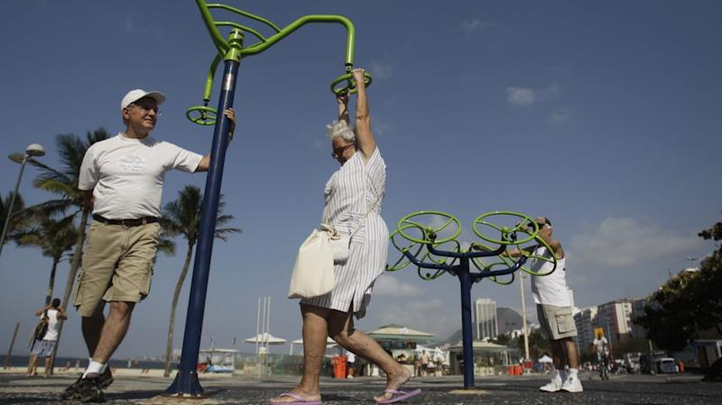 an image of three older adults playing on a plaground