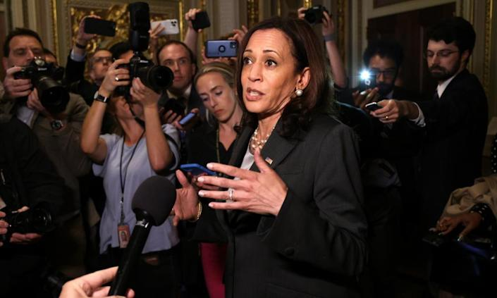 Kamala Harris speaks to members of the media after presiding over the vote.