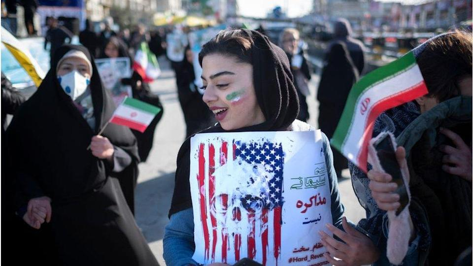 Woman holds anti-US placard in Tehran (11/02/20)