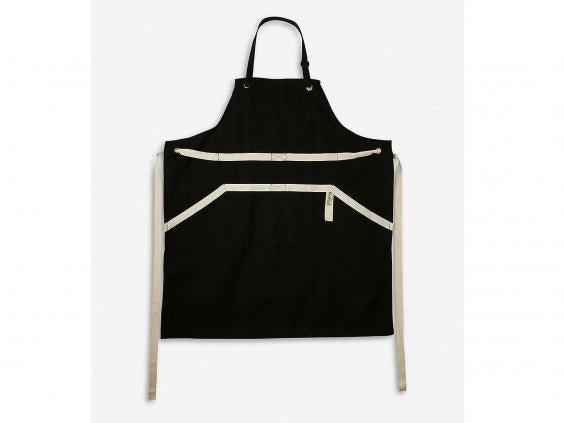This apron from Le Creuset has a front pocket to keep your phone safe and splash-free while you're manning the grill (Selfridges)