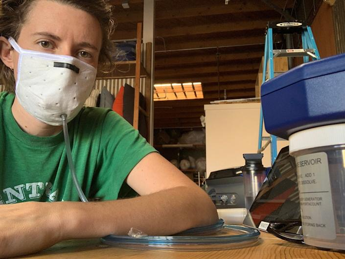 Suay Sew Shop's Heather Pavlu testing mask particle filtration in the lab she and her friends built.