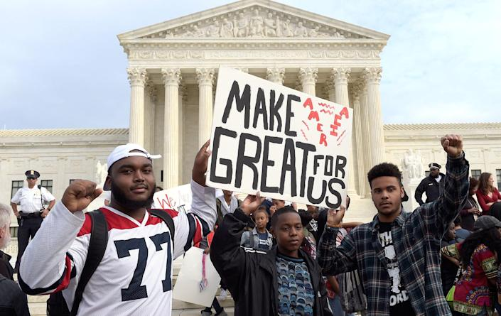 <p>Washington area high school students protest outside the Supreme Court in Washington, Tuesday, Nov. 15, 2016. Hundreds of demonstrators are gathered outside the Supreme Court to protest Donald Trump's election. They are mostly young people who appear to have walked out of school to protest. (AP Photo/Susan Walsh) </p>