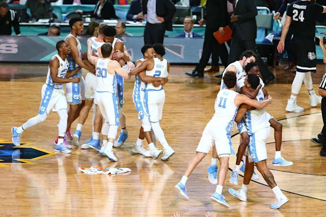 <p>North Carolina Tar Heels players react after defeating Gonzaga Bulldogs in the championship game of the 2017 NCAA Men's Final Four at University of Phoenix Stadium. Mandatory Credit: Mark J. Rebilas-USA TODAY Sports </p>
