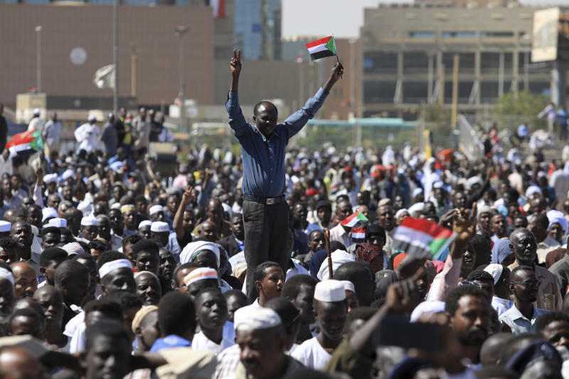"Supporters of Sudan's President Omar al-Bashir attend a pro-government rally in Khartoum, Sudan, Wednesday, Jan. 9, 2019. Al-Bashir told the gathering of several thousands of supporters in the capital that he is ready to step down only ""through election."" The remarks come after three weeks of anti-government protests. (AP Photo/Mahmoud Hjaj)"