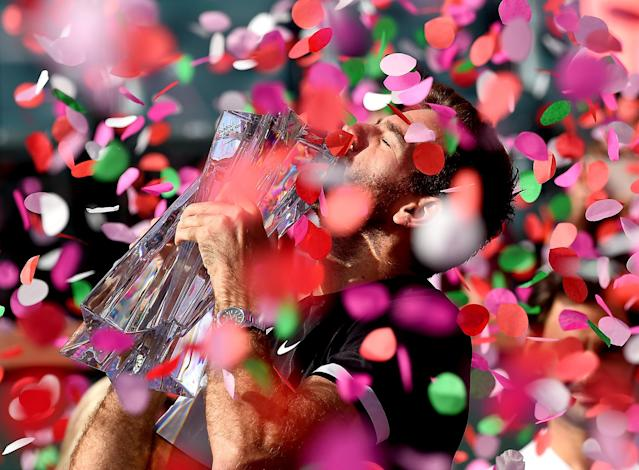 Mar 18, 2018; Indian Wells, CA, USA; Juan Martin Del Potro holds the championship trophy after defeating Roger Federer (not pictured) in the men's finals in the BNP Paribas Open at the Indian Wells Tennis Garden. Mandatory Credit: Jayne Kamin-Oncea-USA TODAY Sports TPX IMAGES OF THE DAY