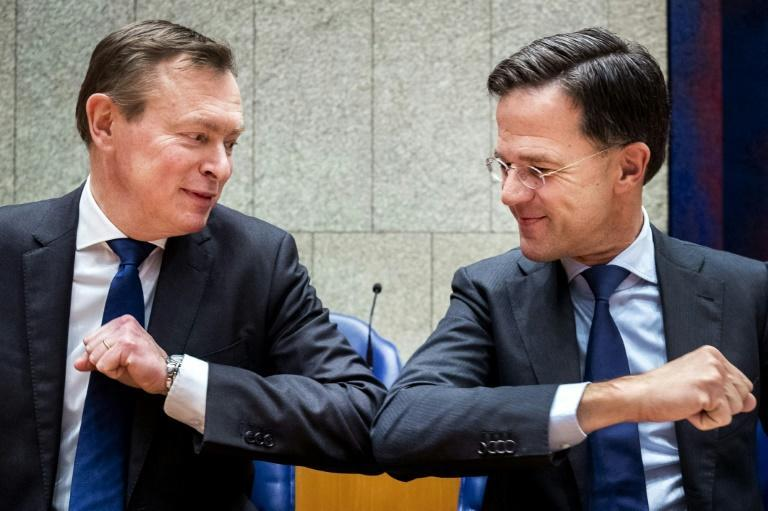 Dutch Prime Minister Mark Rutte (r) and Health minister Bruno Bruins using the elbow bump greeting last week to avoid hand-to-hand contamination
