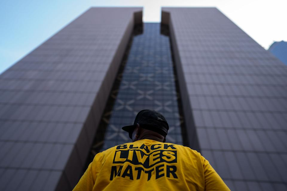 George Floyd's murder one year ago sparked nationwide protests and pledges from all across society to do more in combatting systemic racism. But it sure feels like a massive uphill fight remains. (Kent Nishimura / Los Angeles Times via Getty Images)