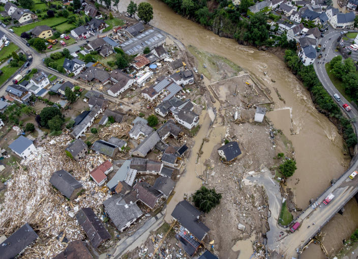 In this July 15, 2021 file photo estroyed houses are seen close to the Ahr river in Schuld, Germany. Due to heavy rain falls the Ahr river dramatically went over the banks the evening before. (AP Photo/Michael Probst, file)