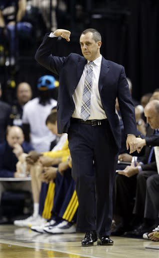 Indiana Pacers head coach Frank Vogel directs his team during the first half of Game 3 of the NBA Eastern Conference basketball finals against the Miami Heat in Indianapolis, Sunday, May 26, 2013. (AP Photo/Nam H. Huh)