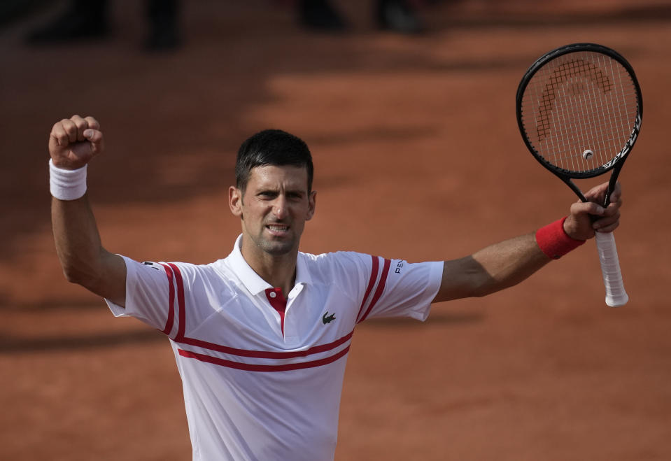Serbia's Novak Djokovic celebrates after defeating Uruguay's Pablo Cuevas in their second round match on day 5, of the French Open tennis tournament at Roland Garros in Paris, France, Thursday, June 3, 2021. (AP Photo/Christophe Ena)