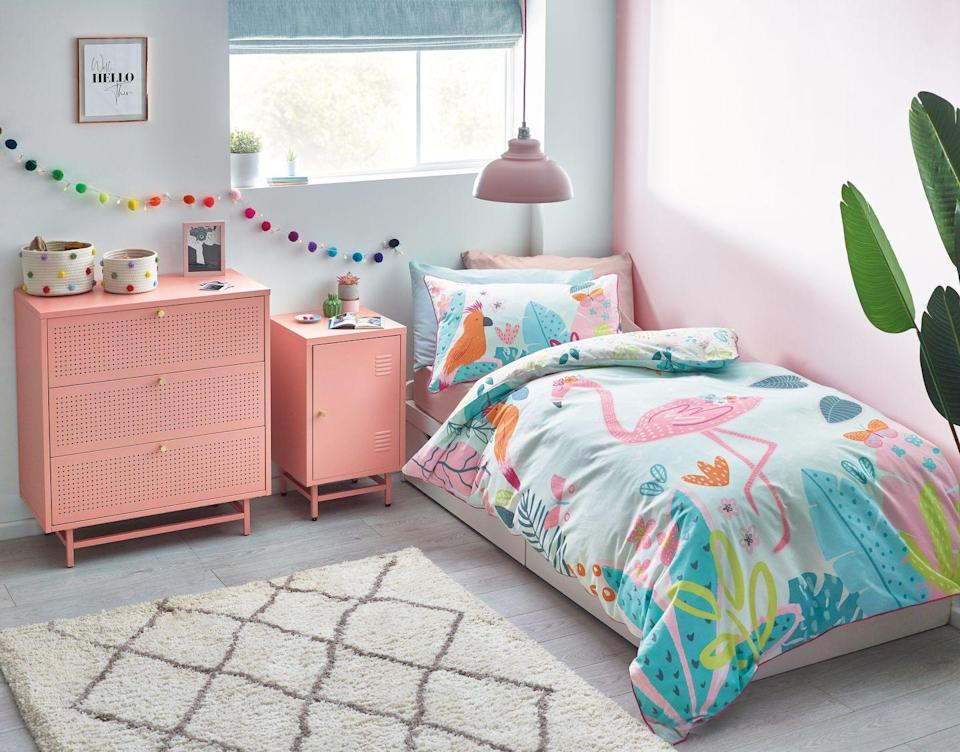 """<p>Coral is a fabulous shade for a girl's bedroom and is stronger than the typical pastel pink. When you have a few permanent pieces of furniture that are coloured, match the rest of the scheme to them. For a quick and relatively cheap update, change the duvet covers, but make sure there's a similar colour to match the existing look.</p><p>Pictured: Pink locker bedside table, <a href=""""https://www.next.co.uk/style/es290242/294009"""" rel=""""nofollow noopener"""" target=""""_blank"""" data-ylk=""""slk:Next"""" class=""""link rapid-noclick-resp"""">Next</a></p>"""