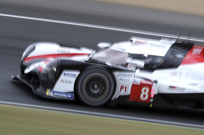 The Toyota TS050 Hybrid No8 of the Toyota Gazoo Racing Team driven by Sebastien Buemi of Switzerland, Kazuki Nakajima of Japan and Fernando Alonso of Spain in action during the 87th 24-hour Le Mans endurance race, in Le Mans, western France, Saturday, June 15, 2019. (AP Photo/David Vincent)