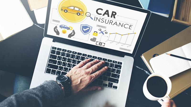 Car insurance shopper viewing policies on laptop