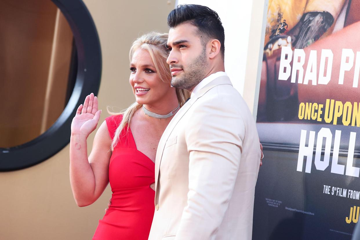 HOLLYWOOD, LOS ANGELES, CALIFORNIA, USA - JULY 22: Singer Britney Spears and boyfriend Sam Asghari arrive at the World Premiere Of Sony Pictures' 'Once Upon a Time In Hollywood' held at the TCL Chinese Theatre IMAX on July 22, 2019 in Hollywood, Los Angeles, California, United States. (Photo by Xavier Collin/Image Press Agency/Sipa USA)