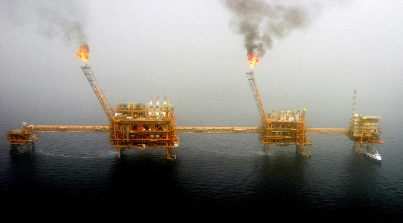 FILE PHOTO: Gas flares from an oil production platform are seen at the Soroush oil fields.