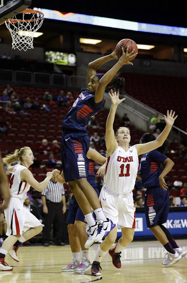 Arizona's Alli Gloyd, center, grabs a rebound above Utah's Taryn Wicijowski (11) during the first half of an NCAA college basketball game in the Pac-12 Conference tournament, Thursday, March 7, 2013, in Seattle. (AP Photo/Ted S. Warren)