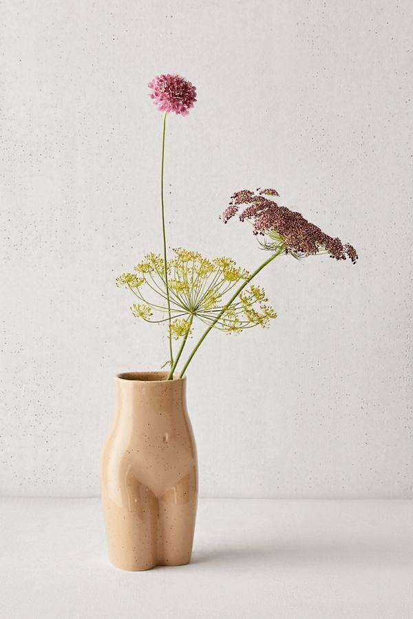 """<h3><span>Urban Outfitters Female Form Vase</span></h3><br>Even though this most wanted decor find is <a href=""""https://refinery29.com/en-us/2020/02/9443349/urban-outfitters-home-sale-2020"""" rel=""""nofollow noopener"""" target=""""_blank"""" data-ylk=""""slk:no longer on flash sale"""" class=""""link rapid-noclick-resp"""">no longer on flash sale</a>, it's still an under-$20 shopping gem worthy of adding to cart (and to your space) ASAP.<br><br><strong>Urban Outfitters</strong> Female Form Vase, $, available at <a href=""""https://www.urbanoutfitters.com/shop/female-form-vase"""" rel=""""nofollow noopener"""" target=""""_blank"""" data-ylk=""""slk:Urban Outfitters"""" class=""""link rapid-noclick-resp"""">Urban Outfitters</a>"""