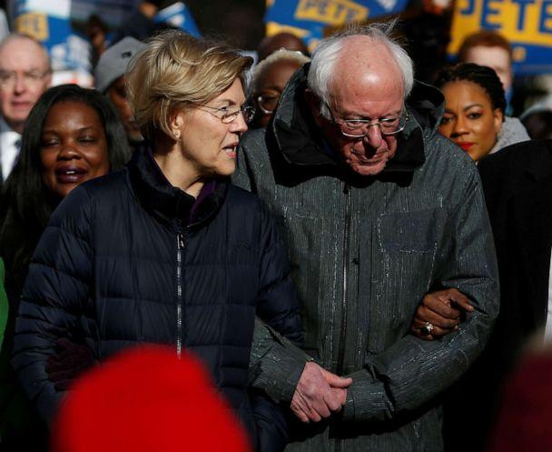 PHOTO: Sen. Elizabeth Warren and Sen. Bernie Sanders, walk arm-in-arm with local African-American leaders during the Martin Luther King Jr. Day Parade in Columbia, S.C., Jan. 20, 2020. (Randall Hill/Reuters, FILE)